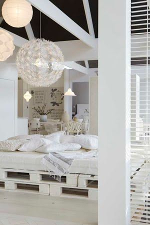 White room with pallet bed