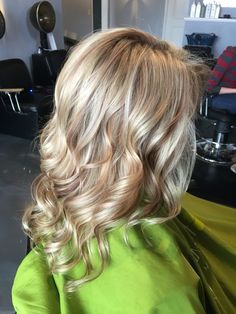 White blonde highlights with caramel lowlights. Great summer alternative to the white highlights with chocolate lowlights. Long layered cut with curls #aloxxi #kreationsbykatie