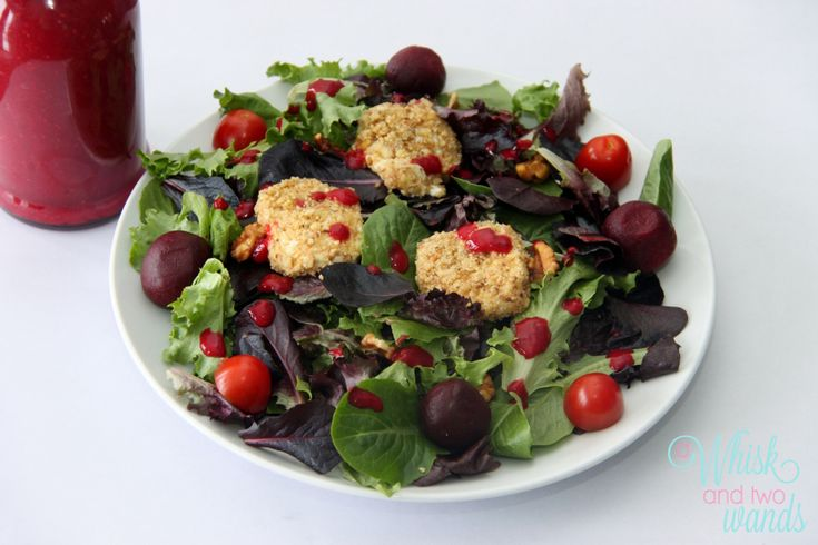 ... Baked Goat Cheese served with Cran- Raspberry Vinegarette Dressing