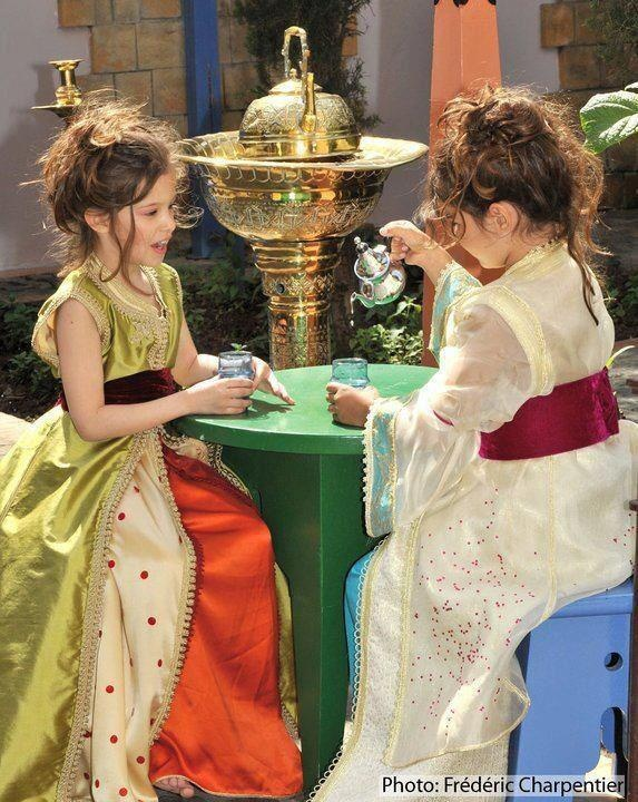 Girls dressed up for a Moroccan tea party - how I imagine my palm reading sessions