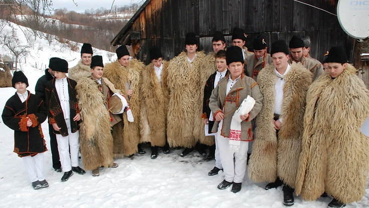 People from Răchițele, Poieni and Negreni, villages in Huedin zone in Vlădeasa Mountains, performing Colinde, winter custom originating in Roman Saturnalia (people going from home to home and singing good wishes to the owners)