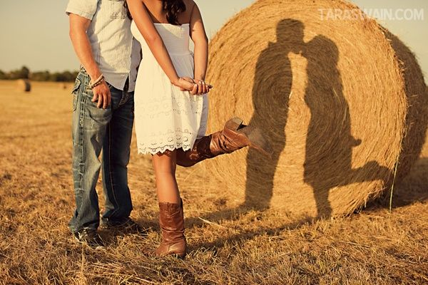 Engagement photo: shadows on a hay bail