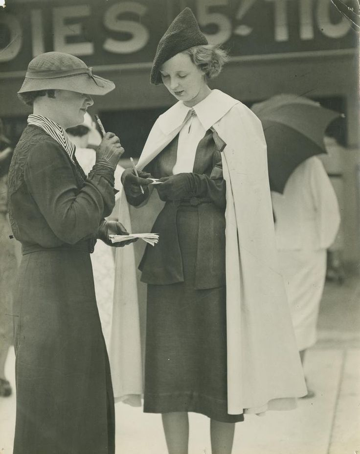 https://flic.kr/p/7LvLy6 | Racetrack Fashions on the field at Doomben, Brisbane, ca. 1945 | Photographer:  George Jackman for Queensland Newspapers Pty Ltd   Location: , Brisbane, Queensland, Australia  Date:  Undated. Circa 1935  Description:   Two ladies studying the form guides are both elegantly dressed.    View this image at the State Library of Queensland:  hdl.handle.net/10462/deriv/120527  Information about State Library of Queensland's collection…