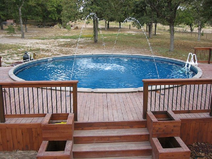 decorating splendid oval above ground pool deck ideas with white pool ladder and brown chair dinning set with brown umbrella design - Deck Design Ideas For Above Ground Pools