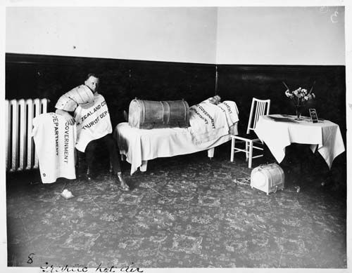In the heyday of the spa some seemingly bizarre treatments were offered. For instance, this hot-air bath exposed the patient to intense dry heat from electric wires. The two men are being treated for shoulder and leg problems at the Rotorua government sanatorium in 1926. Alexander Turnbull Library, New Zealand Railways Collection (PAColl-5167)  Reference: PA1-f-051-27-3