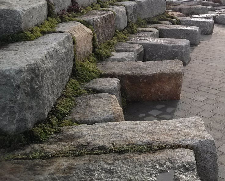 Reclaimed Granite Block Wall Used As Approach To Dam