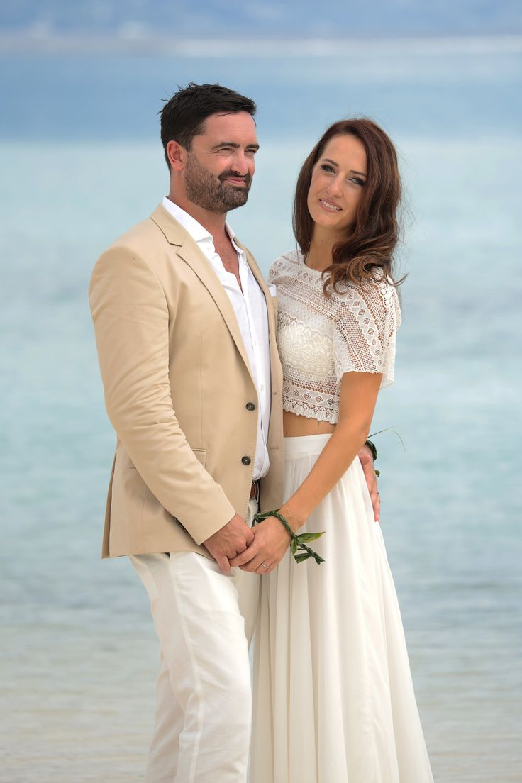 "Our beautiful bride Sylvie and her new husband Regan wearing our ""Cora"" top and ""Cherie"" skirt in Ivory. Courtesy of Johanna from Digitstudio Tahiti"