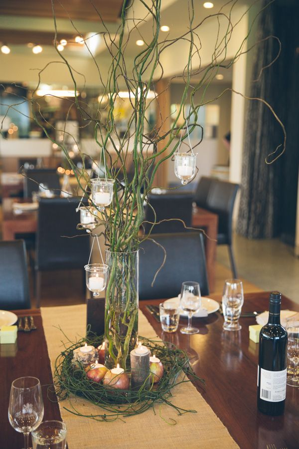 Tall willow twig centerpiece with hanging candles and vine details at Josef Chromys