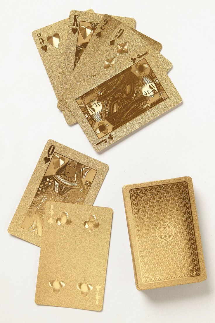 I know they're extravagant and not at all necessary. I still want them!  --  Gold-Dipped Playing Cards - anthropologie.com