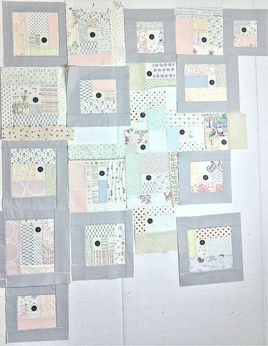 Low volume quilt. I think the black dots are tacks?