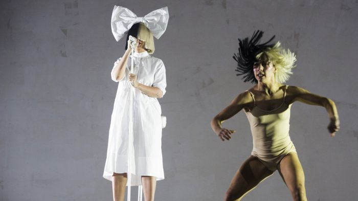 Sia apparently beat an unnamed paparazzi company's attempt to sell nude photos of her by posting one of them herself. The Australian singer-songwriter, renowned for being camera-shy, posted o…
