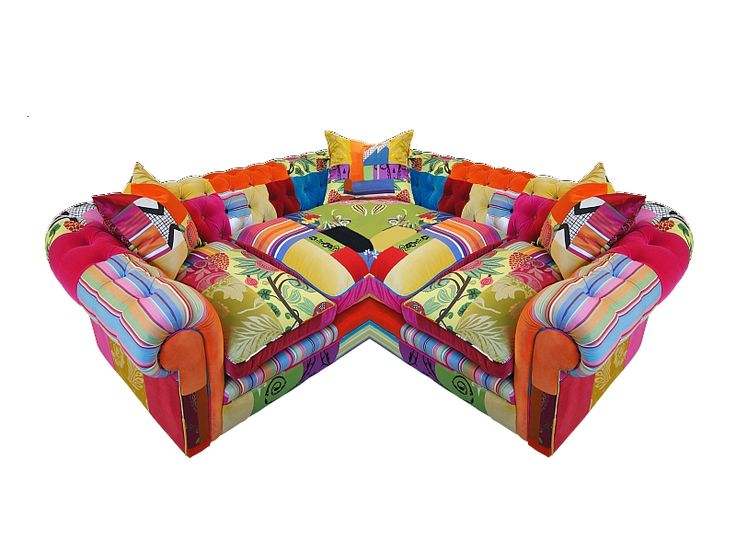 "Multicoloured patchwork corner sofa, by Lisa Whatmough - Two by Two - ""Krissi had been for the guided tour; she liked it, she'd said, then muttered something about unicorn vomit."""