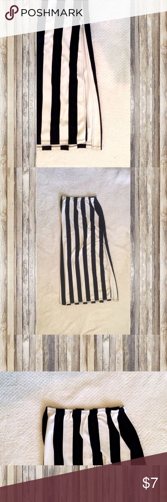 Black and white stripped maxi skirt Striped maxi skirt with slit on leg. Worn a few times will fit a S and a M Papaya Skirts Maxi