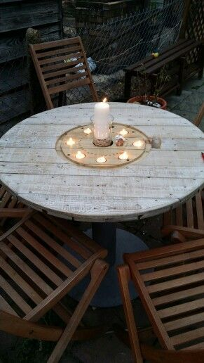 2. TERRACE SPOOL TABLE NESTLING TEA LIGHT CANDLES - 16 Beautiful And Adaptable Spool Table Designs