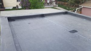Stock image of EPDM membrane installation.