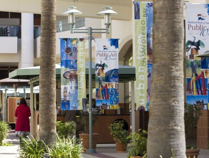 Light pole banners installed using BannerSaver™ brackets