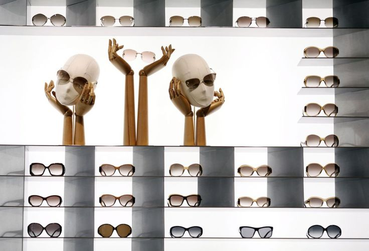 """Louis Vuitton sunglasses sit on display inside the company's new """"Etoile"""" store, operated by LVMH Moet Hennessy Louis Vuitton SA, in a forme..."""
