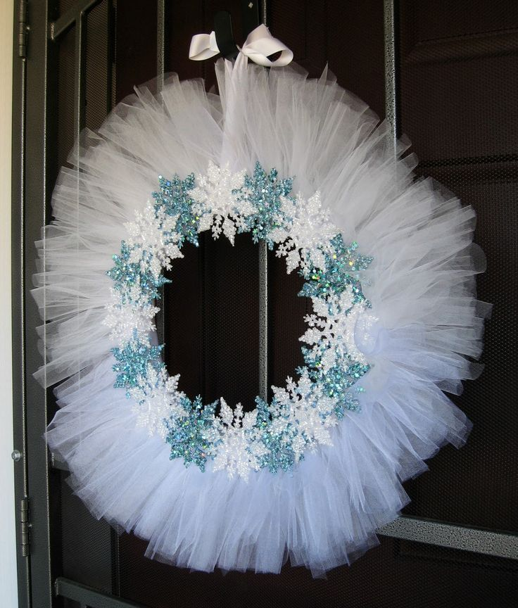 White tulle and snowflake wreath.  Love it!  I might have to do a blue tulle only because my front door is white and you wouldn't really see it, but I will be making this wreath!