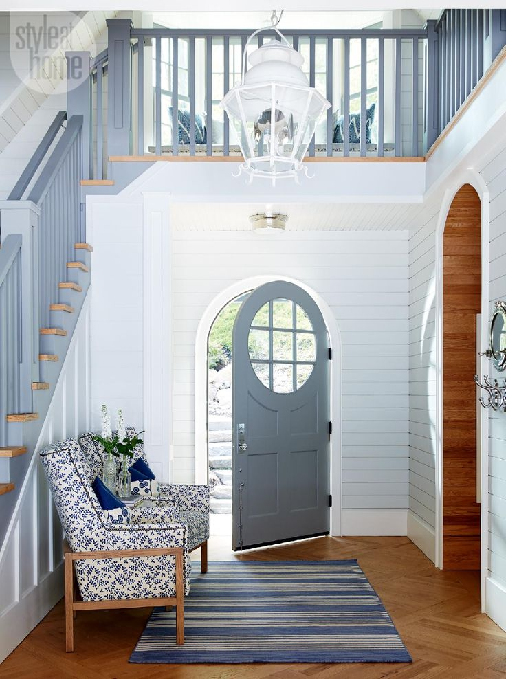 Inviting entryway - House tour: Neutral nautical lake house... love it but smaller. That door <3