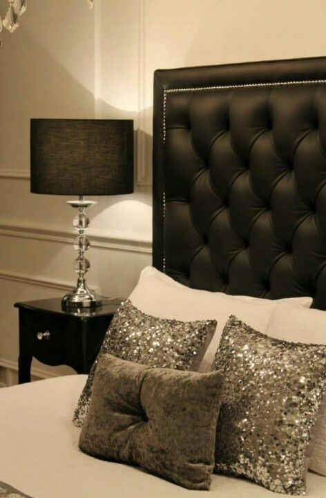 Love the sparkle pillows and black headboard!