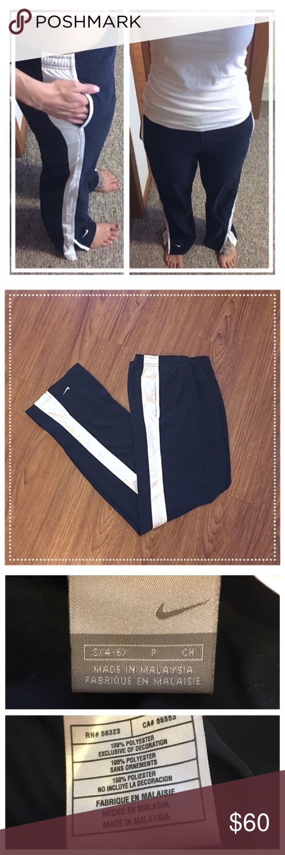 """Nike navy blue/white boot cut pants with pockets 📦Same day shipping (as long as P.O. is open for business). ❤ Measurements are approximate. Descriptions are accurate to the best of my knowledge.  These classic navy blue and white track pants from Nike feature a 4"""" slit on the outside of each pant leg so that the pants lay nicely over top of your shoes. 100% polyester. Elastic waist with internal functional drawstring. Flat measurements: 15"""" across waist, 10"""" rise, 31"""" inseam. Excellent…"""