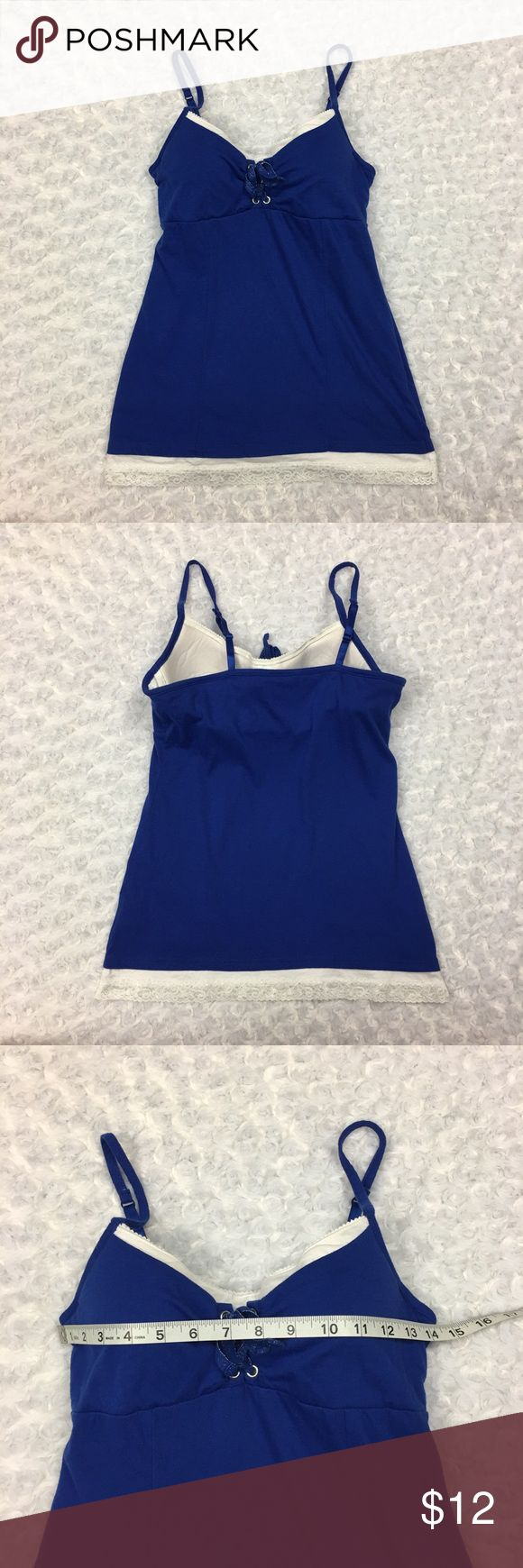 Blue Tank Top w Spaghetti Straps Built in Bra GLO Jeans Brand Royal Blue Tank Top w Spaghetti Straps Built in Padded Bra   Size: Juniors Large.  Condition: Gently used, small blemish on left breast. SEE PHOTOS * This listing is for ONE (1) Top *  - Built in underwire padded bra. - Built in bra is white - White lace trim on the bottom of shirt - Blue ribbon tied in the front for decoration   * See photos for measurements and more details *  Please note: Color may vary slightly due to…