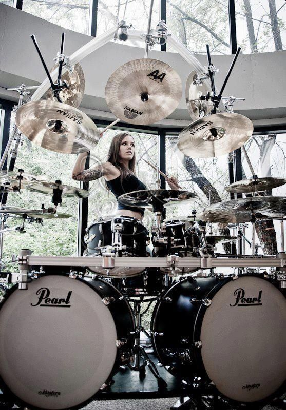 Drummer.  If she can play I'm in love.  If not, oh well, nice drum set anyway.