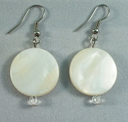These are beautiful earrings made of Mother of Pearl discs. They measure at 2 cm.