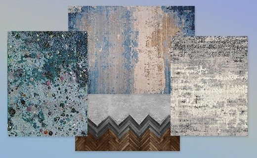 Parquets, tissus et panneaux décoratifs se donnent de faux airs de bois cérusé, de béton patiné ou d'acier oxydé. Les matériaux suggèrent les effets du temps.