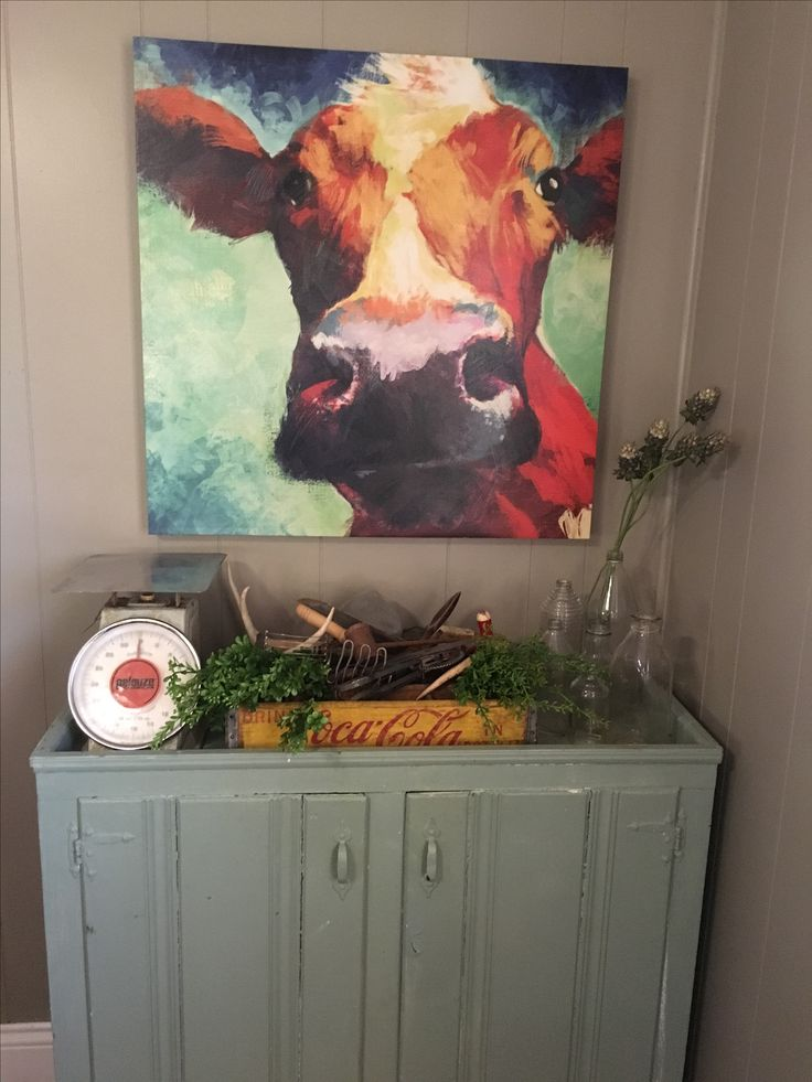 Cow picture with farmhouse decor.