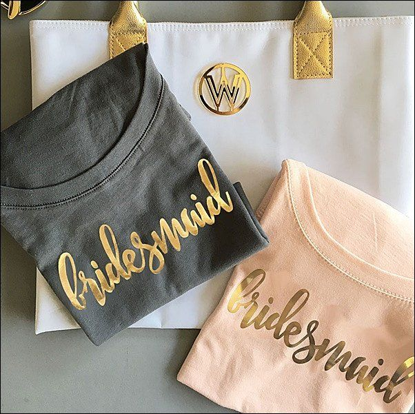 Trendy gold metallic foil t-shirts make a fun gift for your bridal party to wear at your wedding related activities. Select from blush, white, black or grey and bridesmaid, maid of honor or matron of