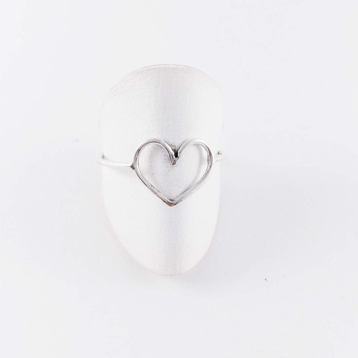 A personal favorite from my Etsy shop https://www.etsy.com/listing/508935814/anillo-midi-corazon