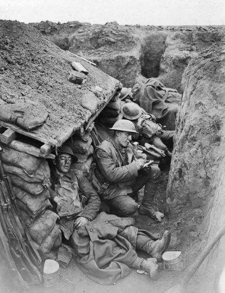 Most activity in front line trenches took place at night under cover of darkness. During daytime soldiers would try to get some rest, but were usually only able to sleep for a few hours at a time.Pictured: 4 Canadians  sleeping and writing letters in the trenches near Willerval.