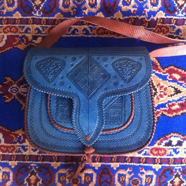 Authentic Moroccan leather bag. The bag craftsmanship is inspired by the ancient culture of Morocco. The hand embossing consists of geometrical Moroccan Architecture symbols and culture folk.