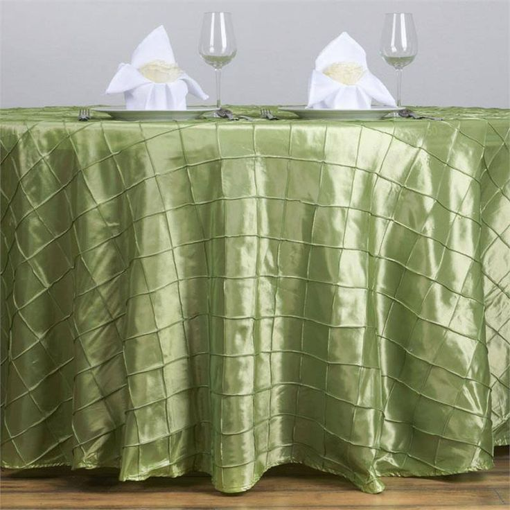 """Apple Green Pintuck Tablecloths 120"""" Round - Pintuck is actually a fold of fabric that is stitched intricately to hold it in a place, very much like a pleat. These lovely pleats impart a decorative effect to the fabric by fashioning a visual line at a chosen point. They effortlessly bridge vintage and contemporary styles to create a majestic new classic look. If you do not want your celebration to blend in with other weddings, birthdays, and anniversaries, try our premium quality pintuck…"""