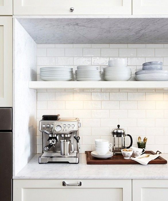 Open shelves in kitchen and stainless steel coffee maker