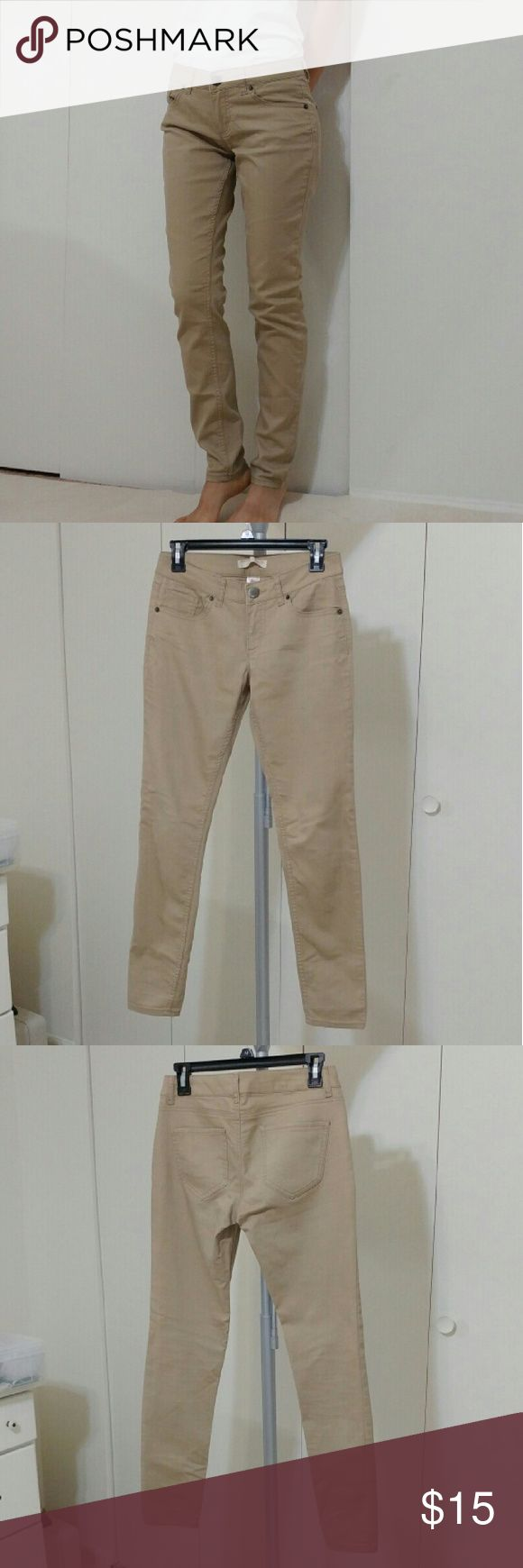 Beige/Tan Skinny Jeans Worn for a week for work. SUPER COMFY!! Stretchy material. Great for work. Gently used! The size is 7 youth but it fit great on me (my size is 0) No Boundaries Pants Skinny