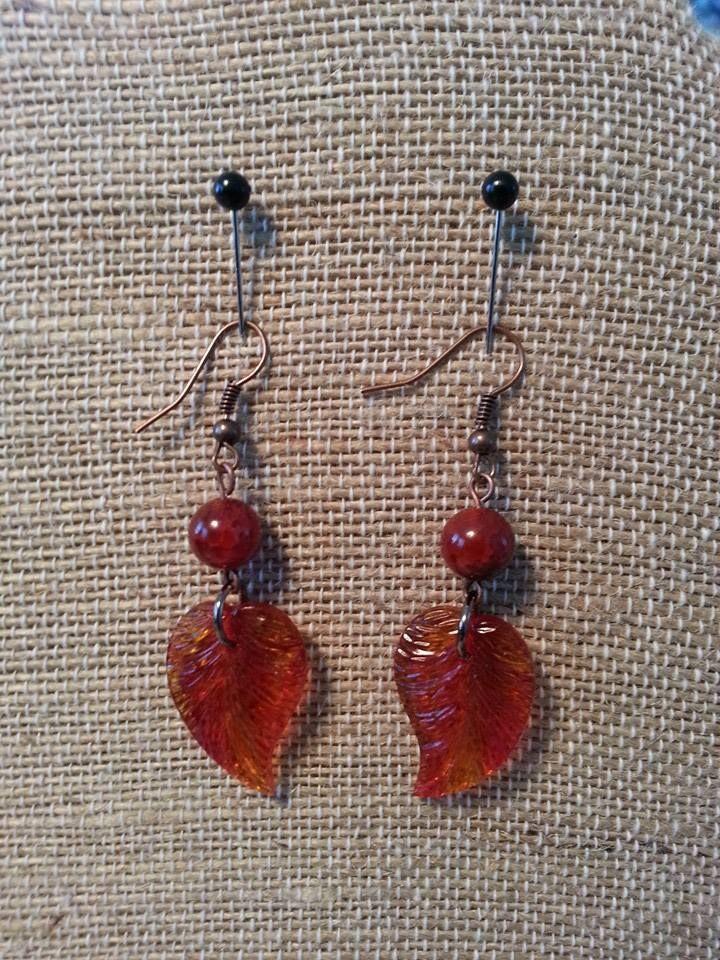 Orange/Red glass leaf with antique bronze wire.