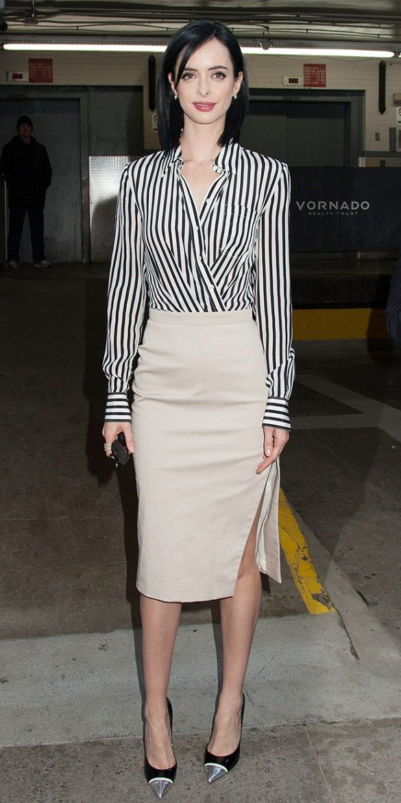 Krysten Ritter wearing a fashionable striped wrap blouse, beige pencil skirt and metallic-toe pumps