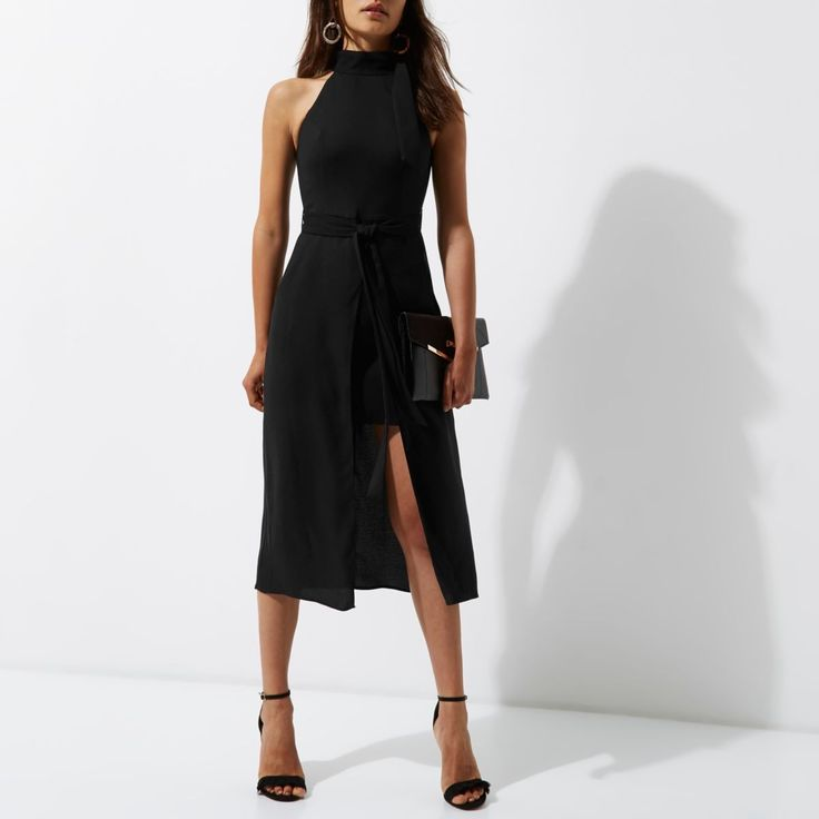 Woven crepe fabric High neck with tie detail Sleeveless Tie waist Side slip pockets Front split Mini skirt underlay Concealed zip back fastening Our model wears a UK 8 and is 175cm/5'9'' tall