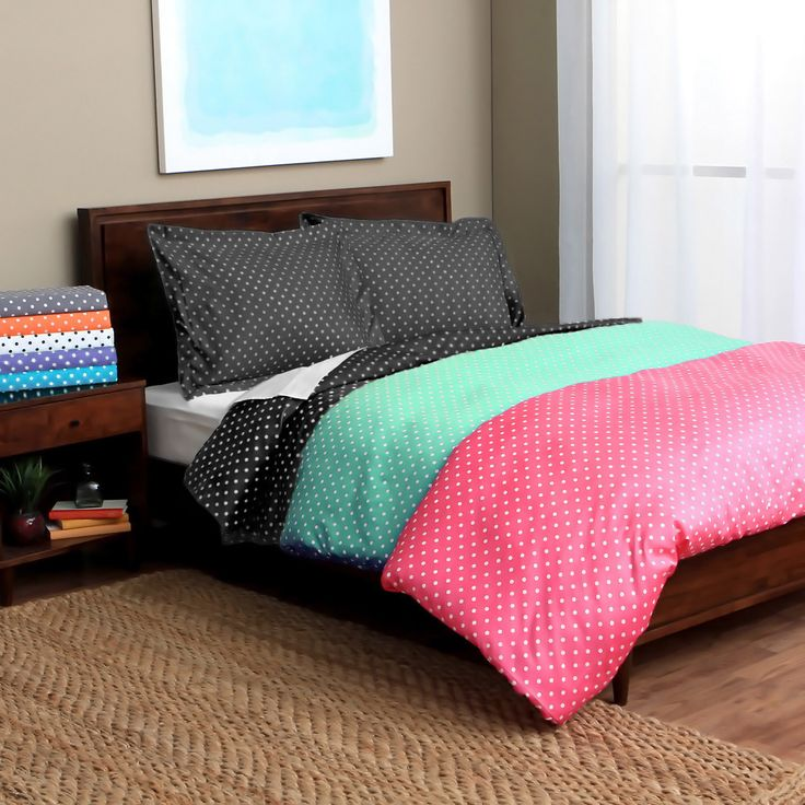 Bring lively two-tone color to your bedroom with this whimsical polka dot duvet cover set. Available in several vibrant shades, this wrinkle-resistant cover and sham set features a luxurious and comfortable 600 thread count design.
