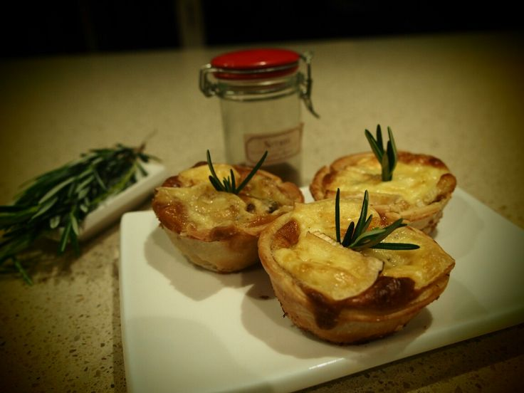 Home cooking. Onion & rosemary tarts.