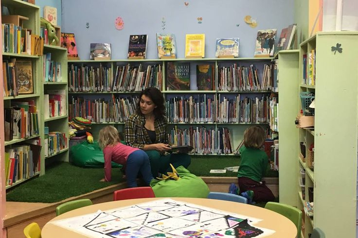 Mother Raquel Romano with her children in the library, Tuesday, October 18, 2016.