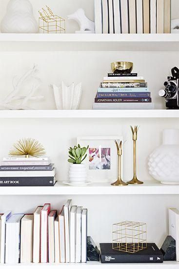 30 Amazing Design Ideas to Make Every Room in Your House Prettier - gorgeous styled bookshelf with pops of gold metal, and white ceramic decorative objects