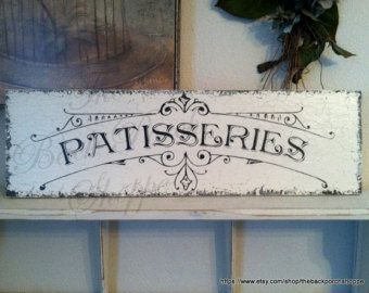 Another Sweet Petite sign from The Back Porch Shoppe! Sweet sign for your childs room! Perfect for hanging on a door or on a wall. This sign has an architectural rose embellishment for added vintage beauty, and also a beautiful sheer ribbon for hanging. Perfect baby shower gift! Order one with the new little girls name......it will be the hit of the shower! Measures 9 wide x 5 high. Name is included. Please leave a note when you check out where it says NOTE FROM BUYER with the name you…