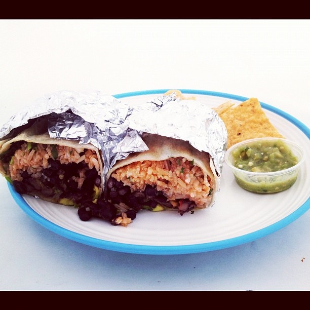 Today's lunch: a #vegan burrito loaded with black beans, avocado, and pico de gallo, SF-style. - @vegnews- #webstagram