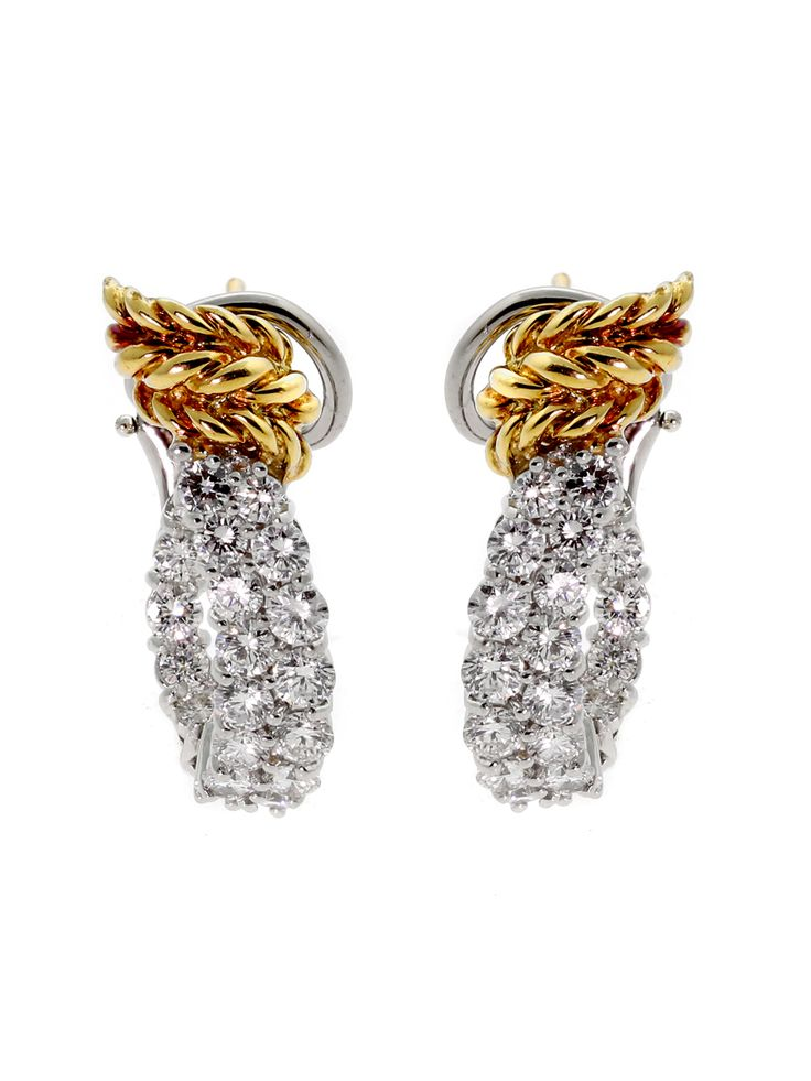 Tiffany & Co Schlumberger diamond earrings adorned with round brilliant cut diamonds set in Platinum and touched with 18k yellow gold.