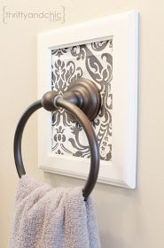 Decorative framed towel holder. Definitely need to make this for the bathroom!!