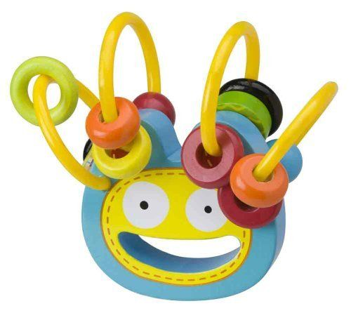 Alex Squiggle Wooden Rattle by Alex. $11.79. From the Manufacturer                Squiggle Wooden Rattle - Fun wooden rattle includes beads that easily slide along soft tubing. Max's cute face is featured. Bright and colorful. Part of the mix 'n max baby toy line. Perfect for ages 3 months and up.                                    Product Description                You'll giggle when you shake the squiggle to watch the beads wiggle! Wooden Max face is easy to grip...
