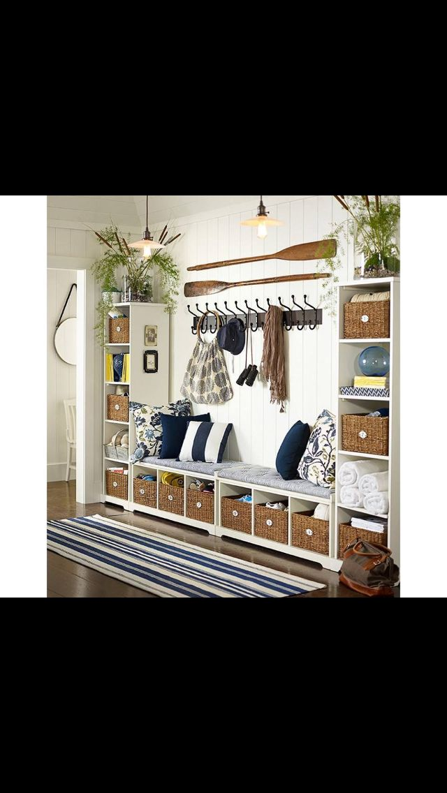 Entryway Pottery Barn. Create walls using shelves with baskets for storage. Benches and hooks in between. :)